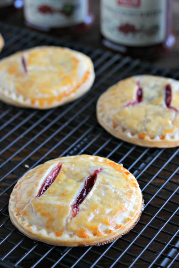 lingonberry hand pies on a cooking rack