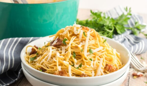 spaghetti carbonara in a white bowl