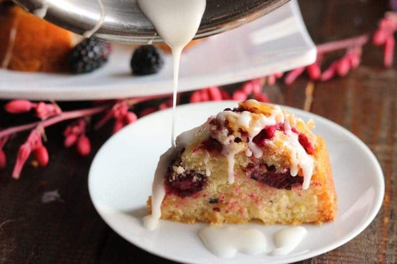 A light and fluffy yogurt bundt, dotted with fresh blackberries and made even better with the addition of vanilla yogurt. This colorful bundt will be perfect for Mother's Day brunch!