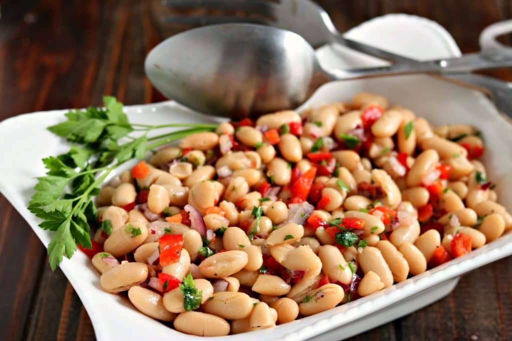 Served chilled or at room temperature, this Summery White Bean Salad is great to make ahead, or to grab and go! A 5 minute prep time means you can have it on the table fast!