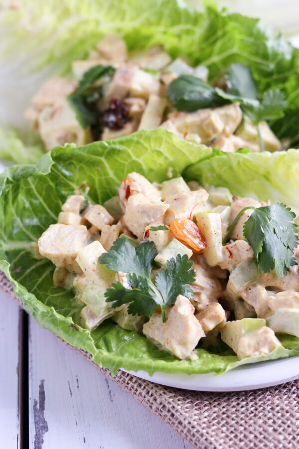 close up of curried chicken salad on lettuce leaves