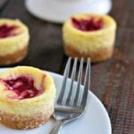 Mini Lemon Cheesecakes with Berry Swirl