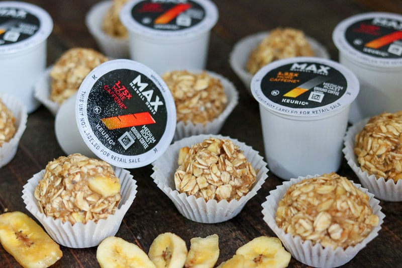 Banana oatmeal energy bites and Maxwell House Max Keurig cups on wood table.