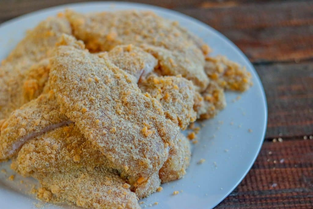 Chicken tenders breaded and ready to be cooked.