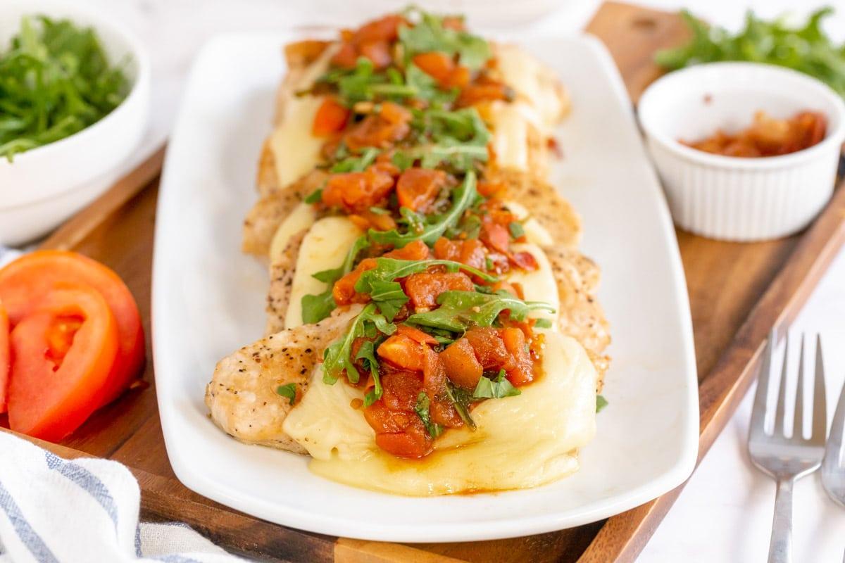 Italian Pork chops on a white platter
