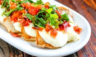 Mozzarella, arugula, tomatoes & balsamic vinegar combine to amp up your weeknight meal. You'll fall in love with these Italian Style Smothered Pork Chops!