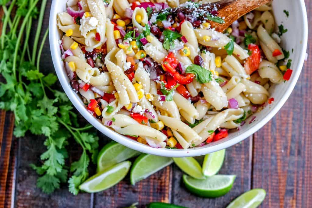 Tuck into this gorgeous, fresh easy Southwest Pasta Salad! Black beans, corn, red peppers, jalapenos & red onions feature in this yummy pasta salad.