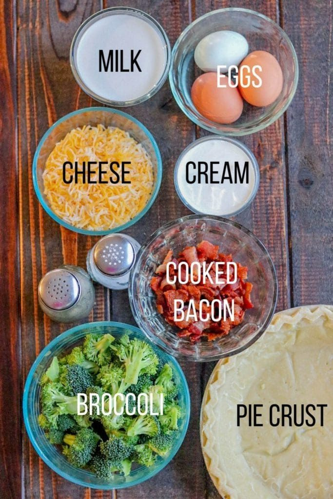 Quiche ingredients laid out on a wooden board