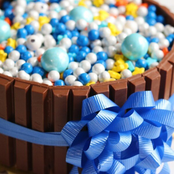kit kat cake with candies, blue ribbon and bow