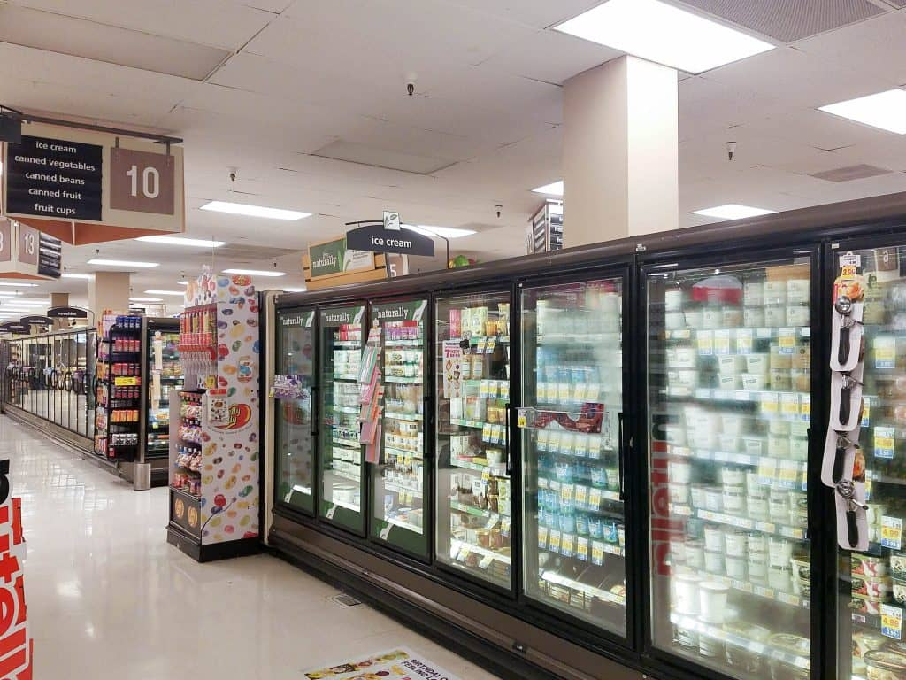 Shot of frozen foods section in grocery store.