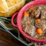 Red wine and rosemary feature in this tasty and tummy warming beef stew recipe - perfect for cold weather! Pair with mashed potatoes or crusty bread!