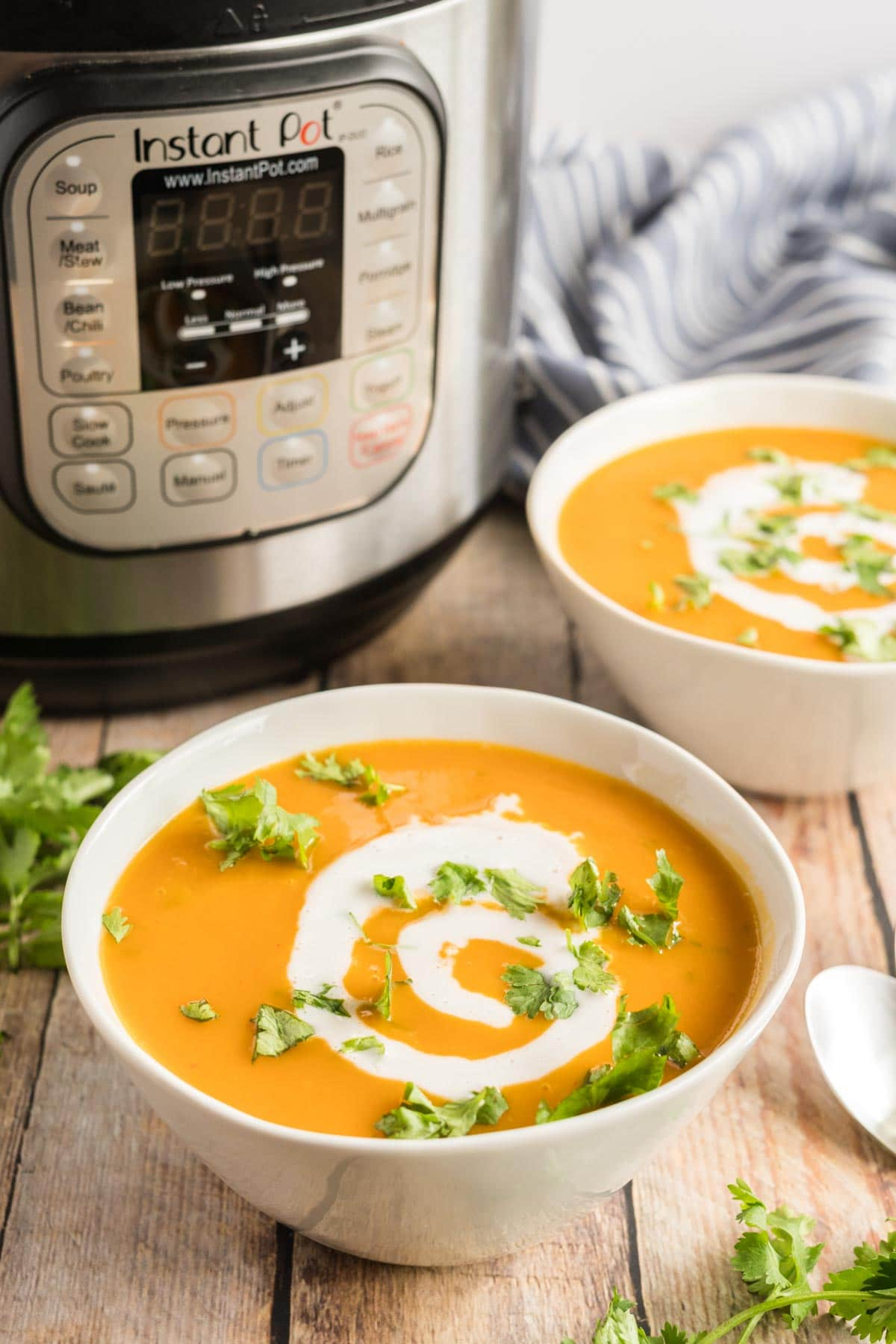 butternut squash soup in white bowls with an instant pot