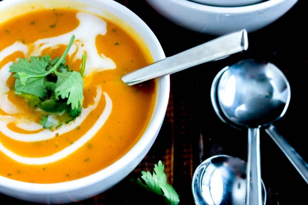 velvety smooth and dreamy Thai Butternut Squash Soup, with a kick of Thai heat, balanced by creamy coconut cream. Cilantro just adds to the party!
