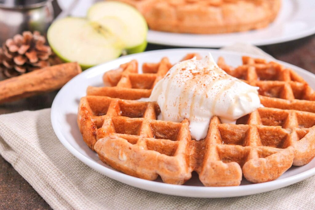apple cinnamon waffle with whipped cream and apples