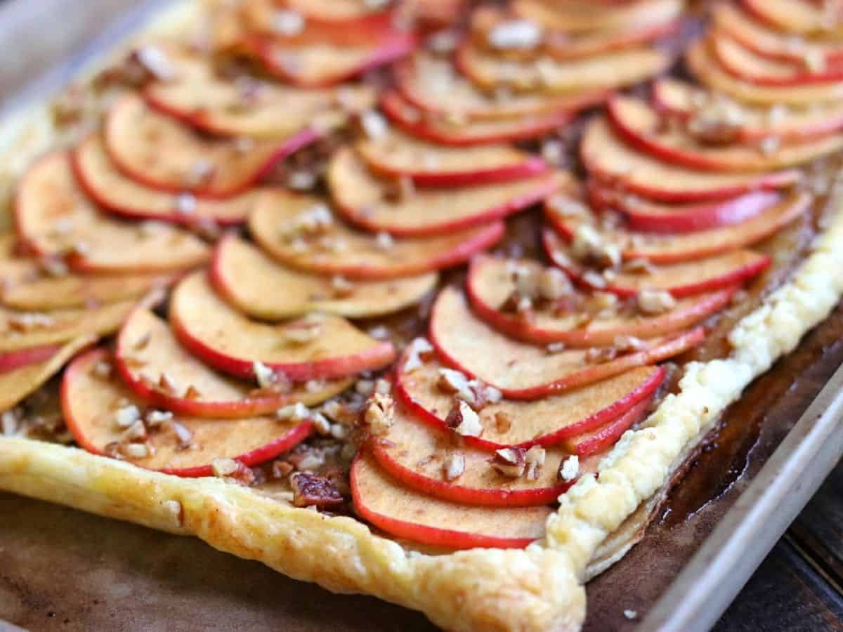 puff pastry apple tart on a cooking sheet