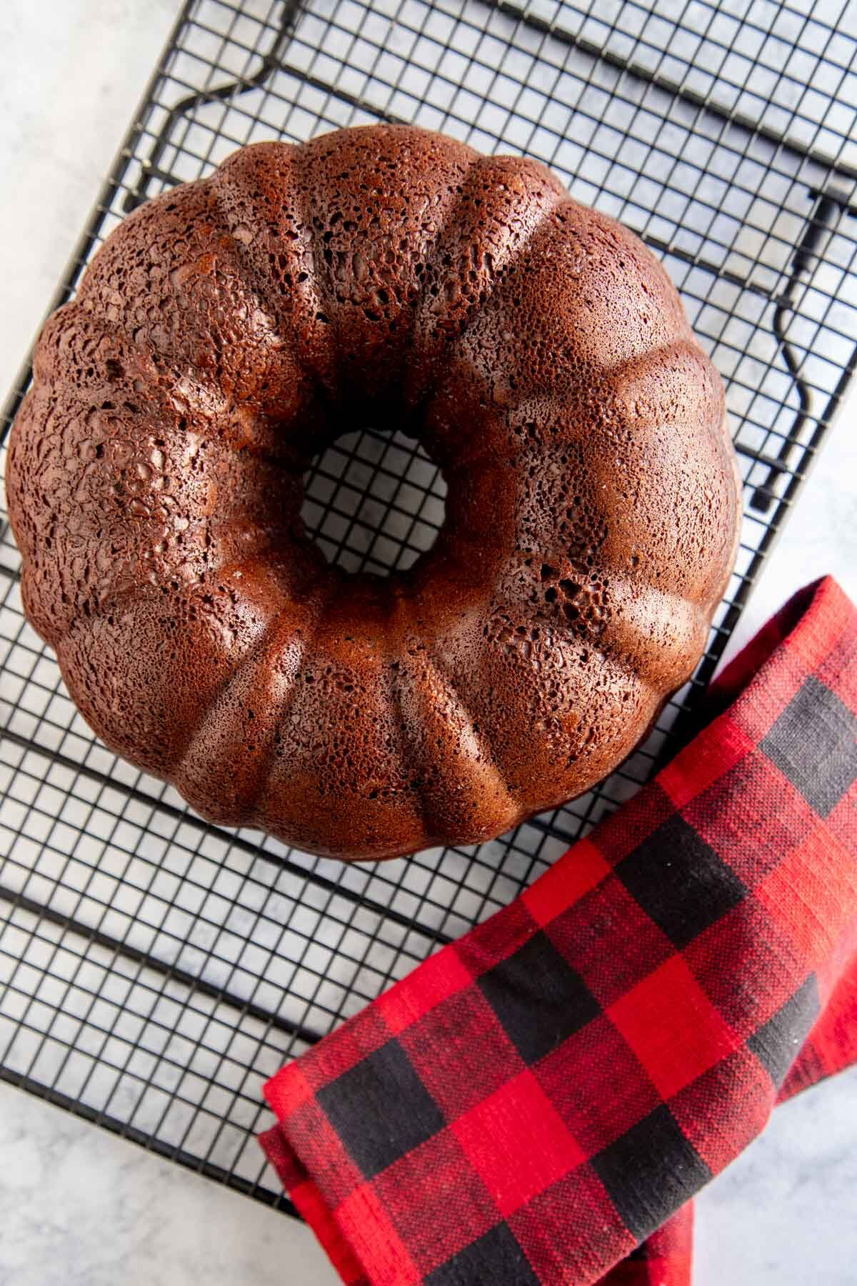 bundt cake out of the oven and on a wire rack