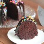 slice of chocolate bundt cake with rainbow sprinkles