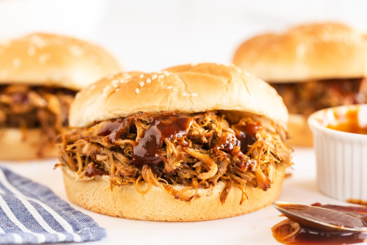 pulled pork in a sesame bun with sauce