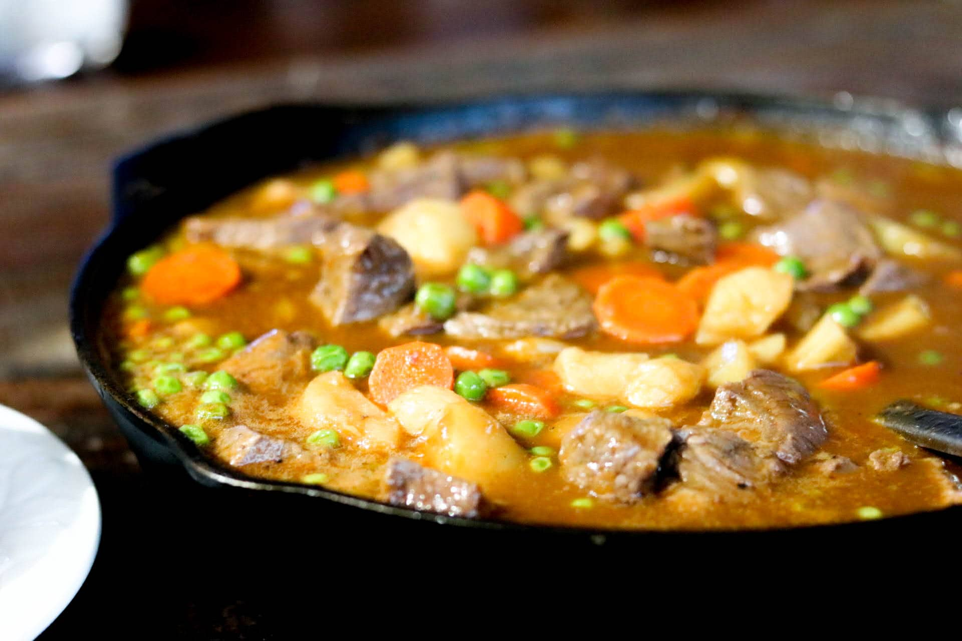 Closeup of beef and Guinness stew in cast iron skillet.