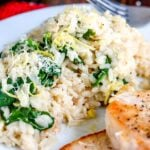 Creamy lemon spinach risotto on white plate.