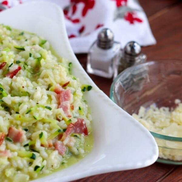 Bacon zucchini risotto in white serving dish.