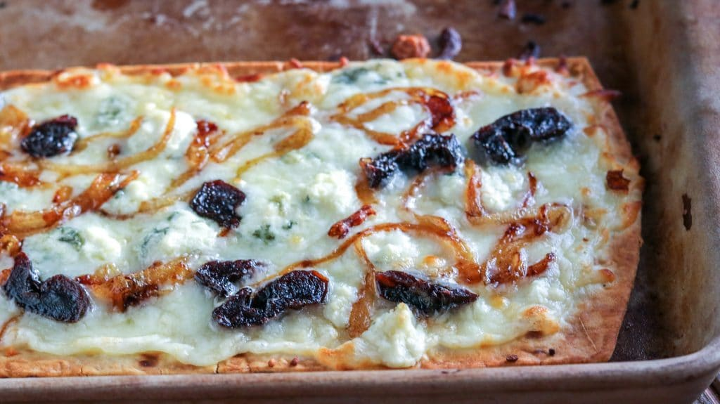 Need an easy and TASTY appetizer or light meal? I've got you covered! I combine grilled onions, blue cheese and California Prunes in this delicious combination of salty and sweet!