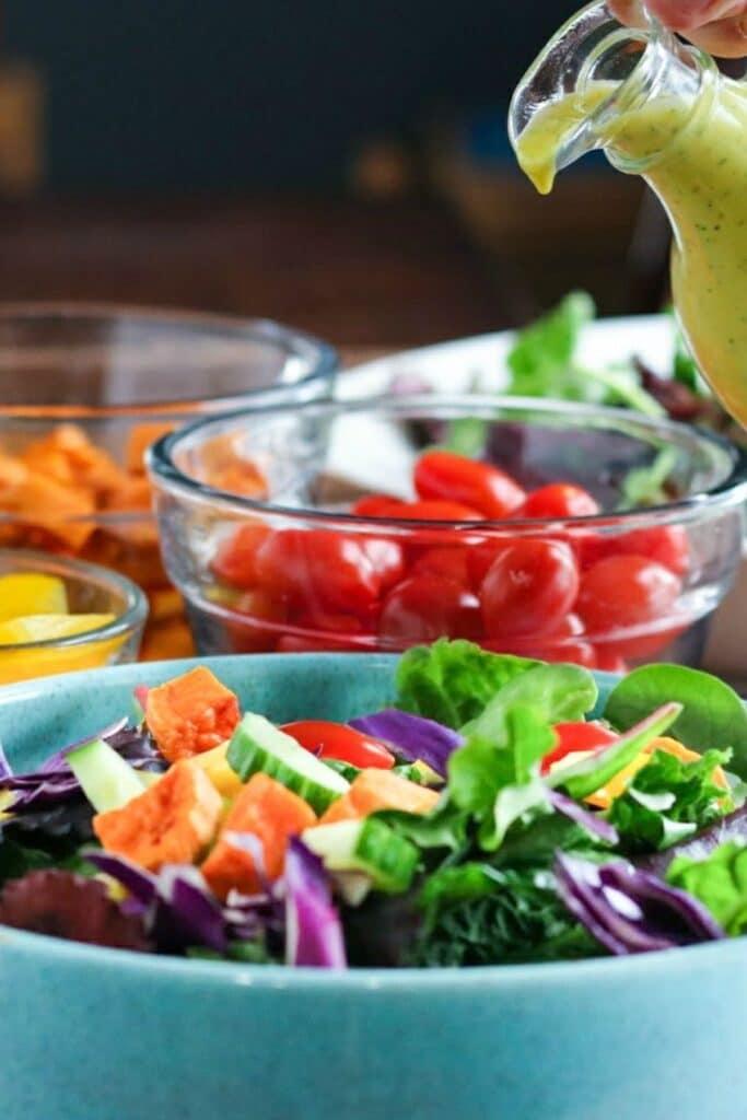 salad dressing poured over a salad