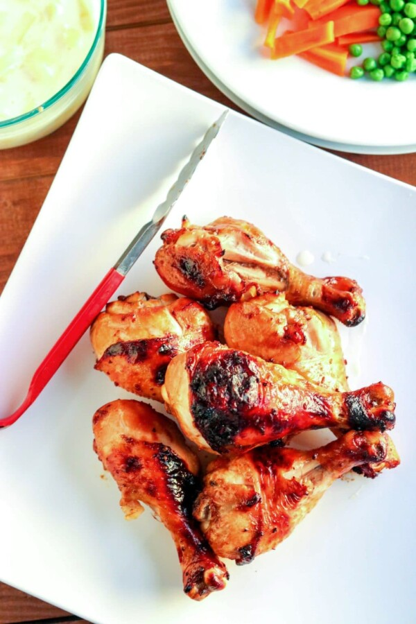 a plate of baked chicken drumsticks