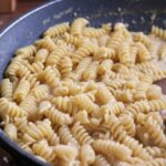 Cooked pasta in pan.