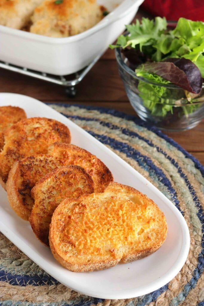crunchy cheesy garlic bread - vertical, plated