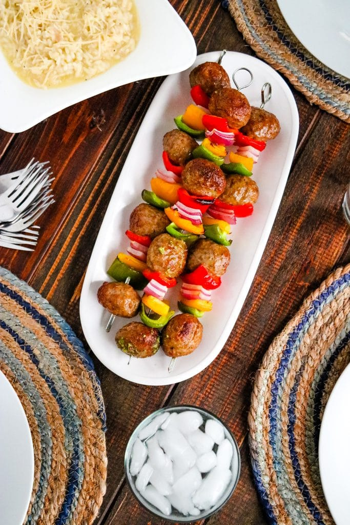 Italian meatball kabobs in white serving dish.