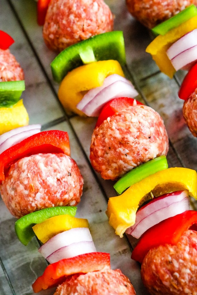 Closeup of uncooked Italian meatball kabobs.