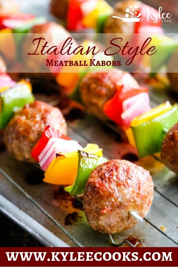 Italian meatball kabobs with bell pepper and onion on baking sheet.