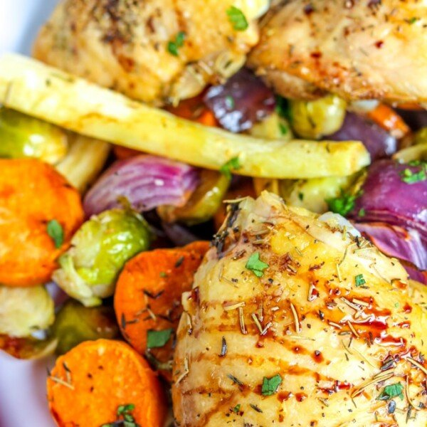 Roast Chicken with Vegetables on a white plate