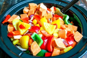 Chopped vegetables in Crockpot.