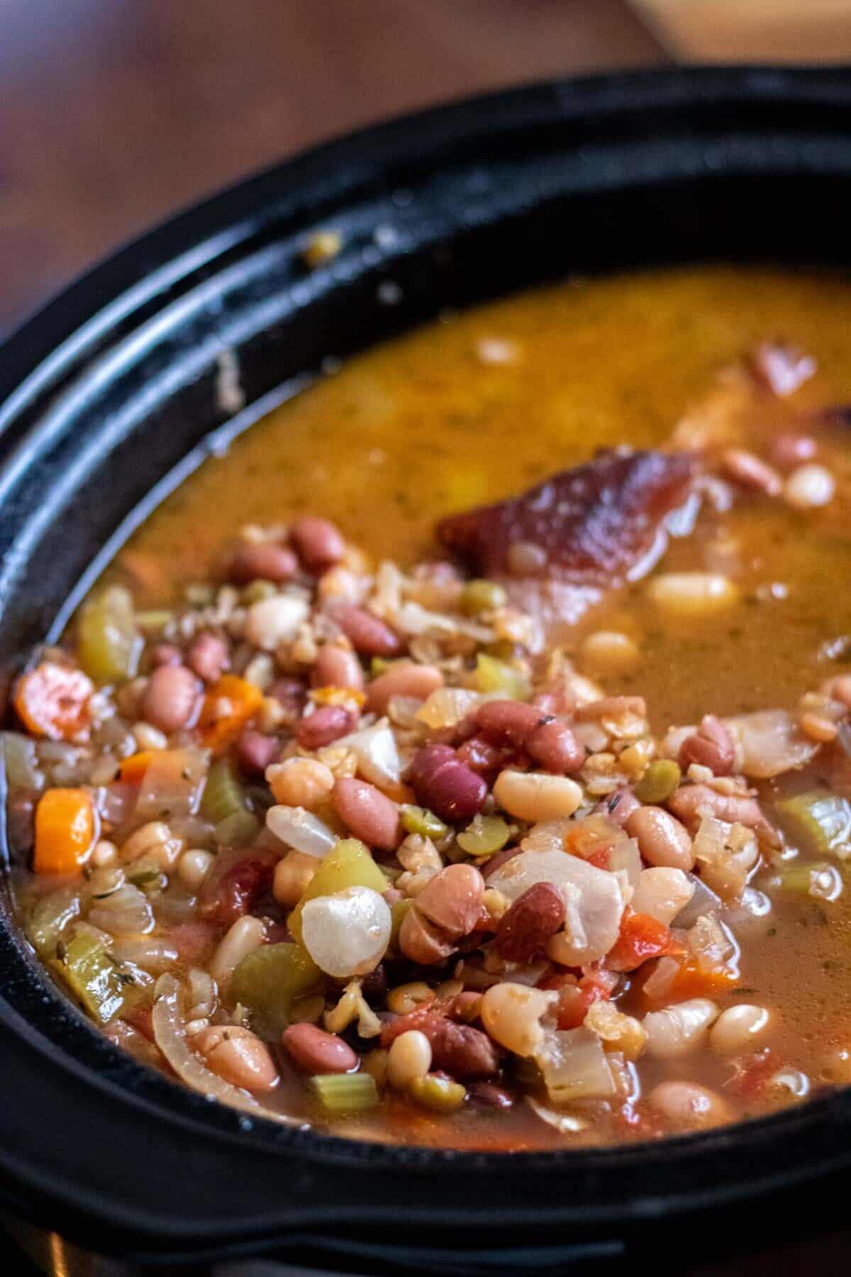 15 bean soup in a black crockpot