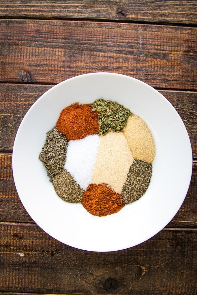 Cajun seasoning ingredients arranged individually on a white plate.
