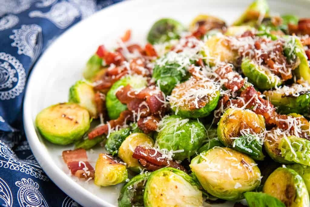 Roasted Brussels Sprouts with Bacon on a white plate