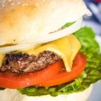Burger with lettuce, tomato, cheese on a homemade hamburger bun