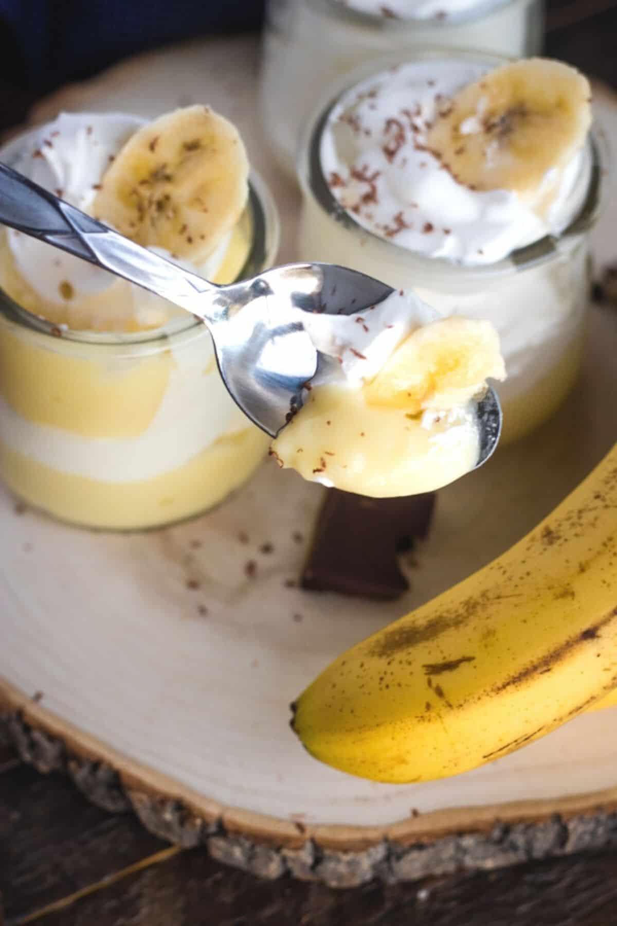 bite of banana cream parfait on a spoon