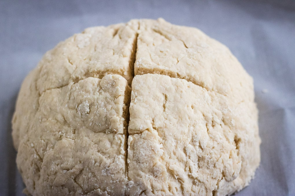 Irish Soda Bread with the top cut into a cross - ready for baking