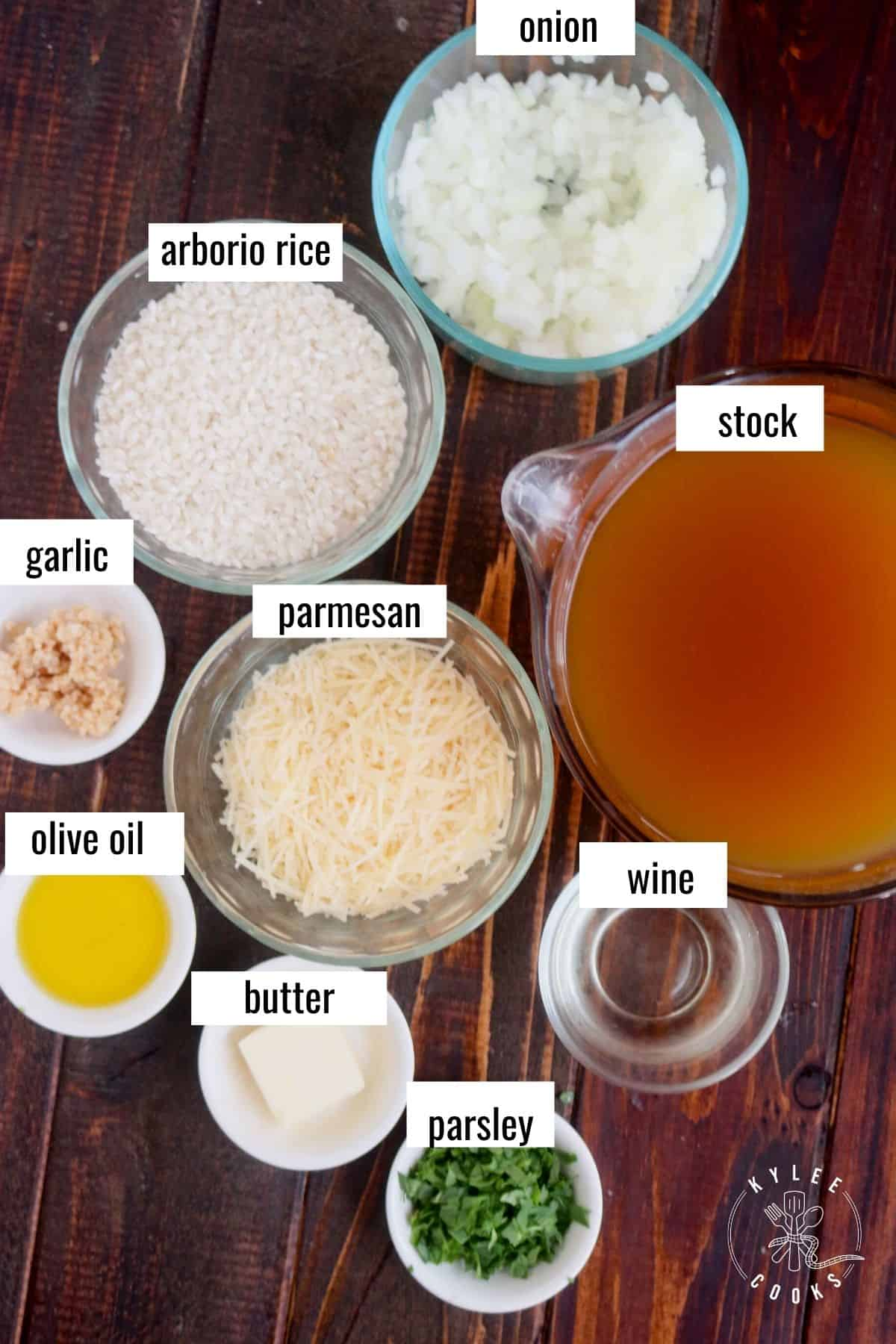 Risotto ingredients labeled on a wooden board