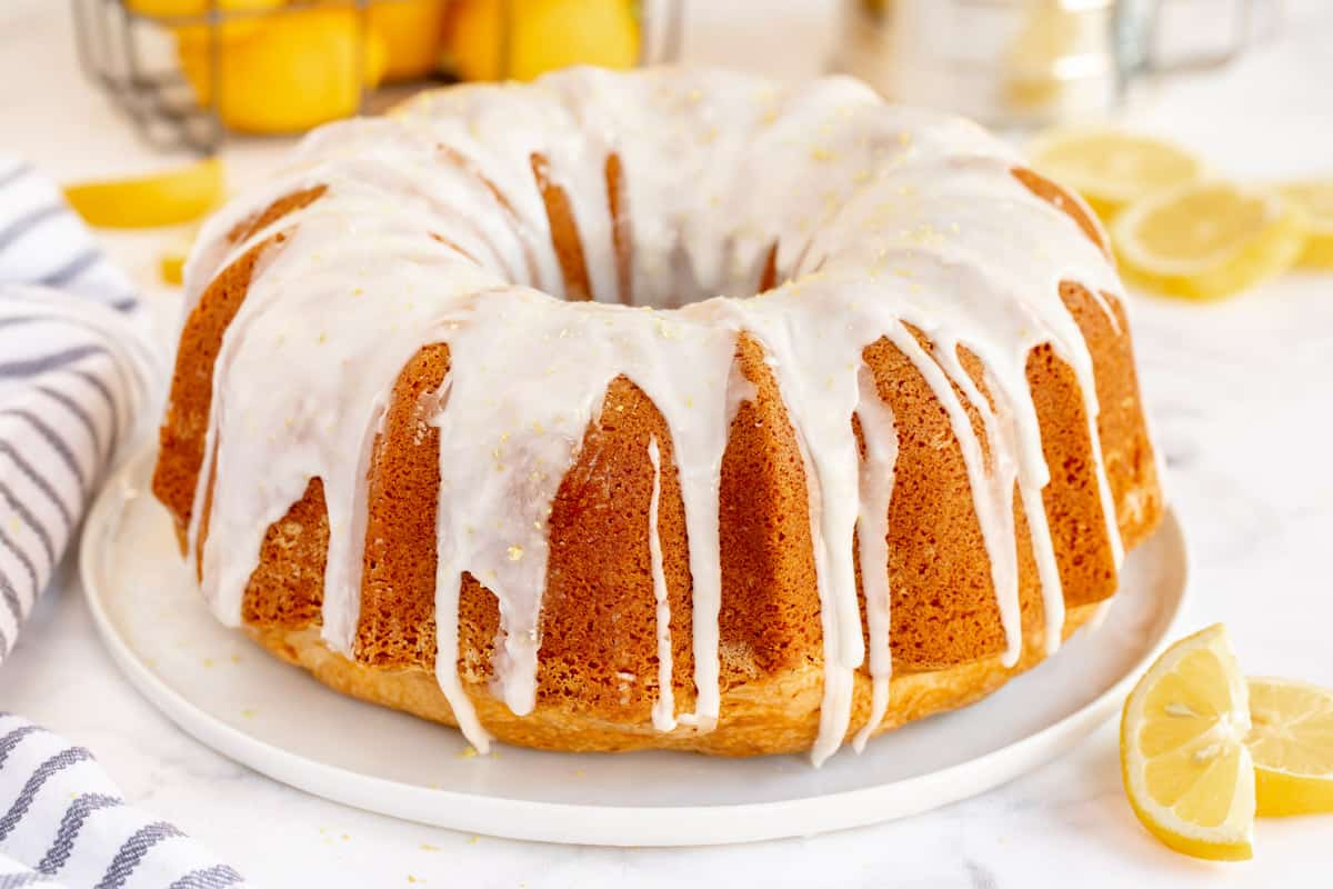 lemon bundt cake with frosting on a white plate