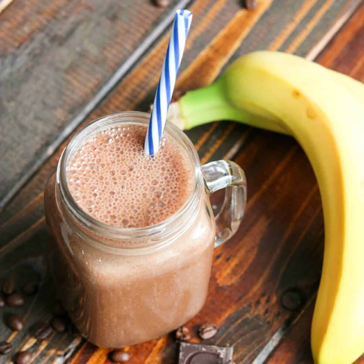 coffee smoothie in a mason jar with a banana