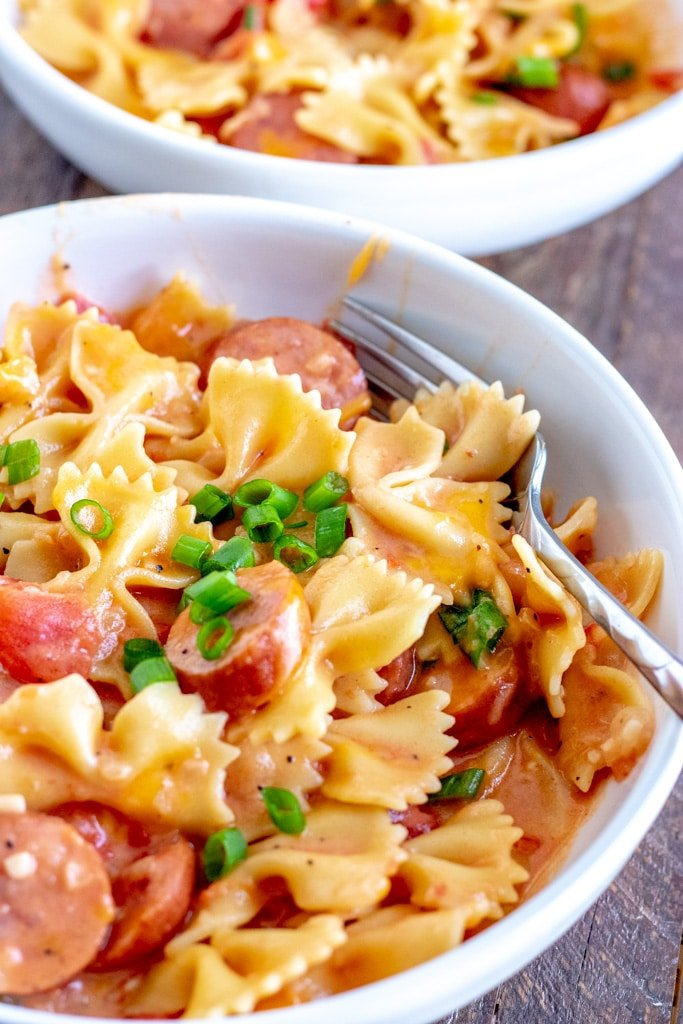 bowl of sausage pasta with a fork