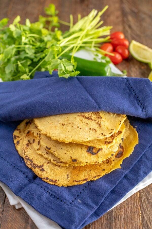 corn tortillas in blue towel
