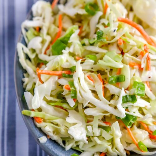 homemade coleslaw with blue striped napkin