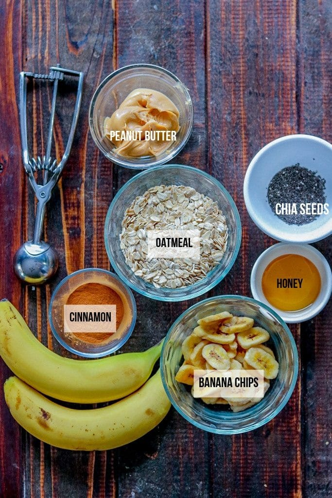 banana oatmeal energy balls ingredients with labels on a wood surface