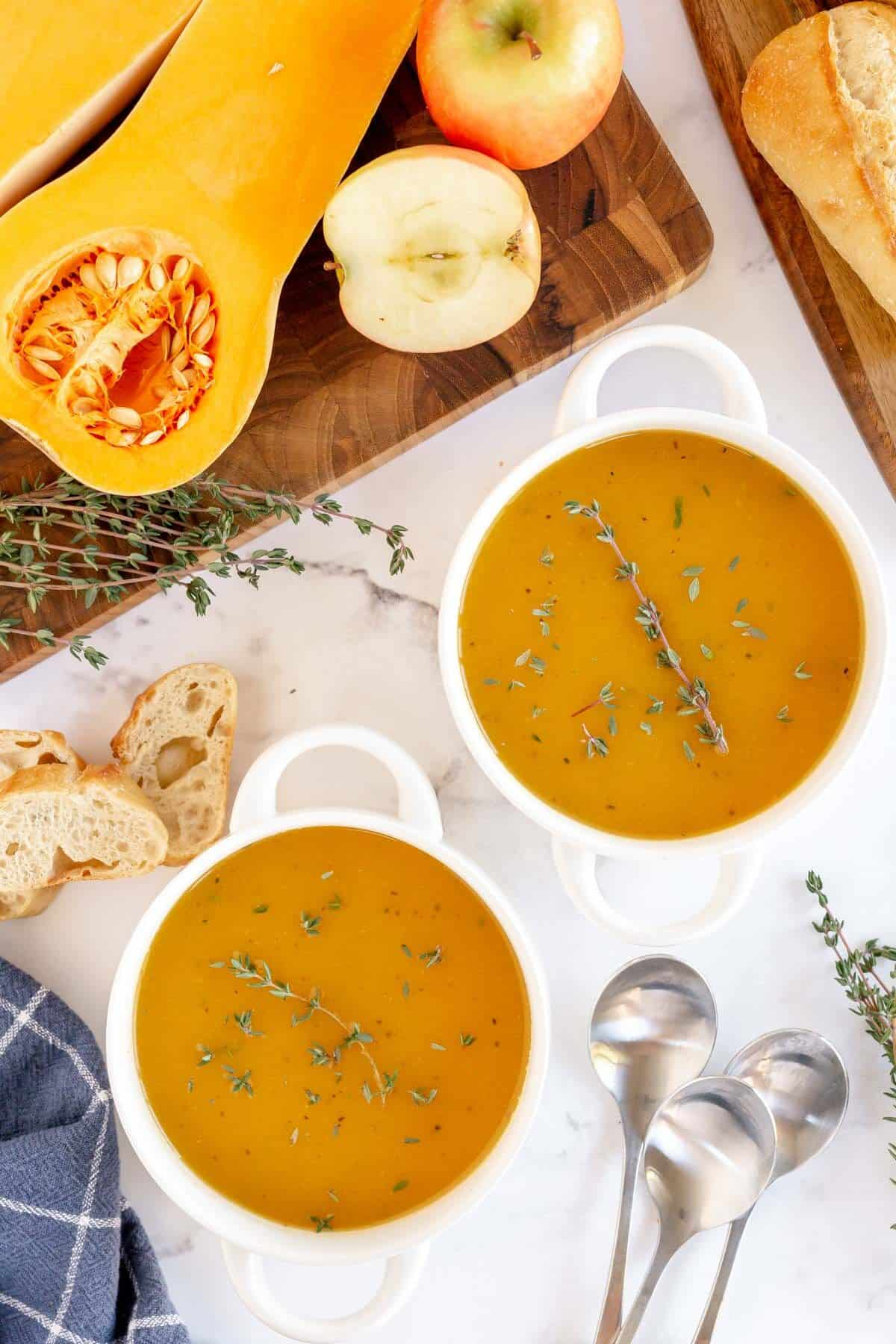 butternut squash soup in two white bowls