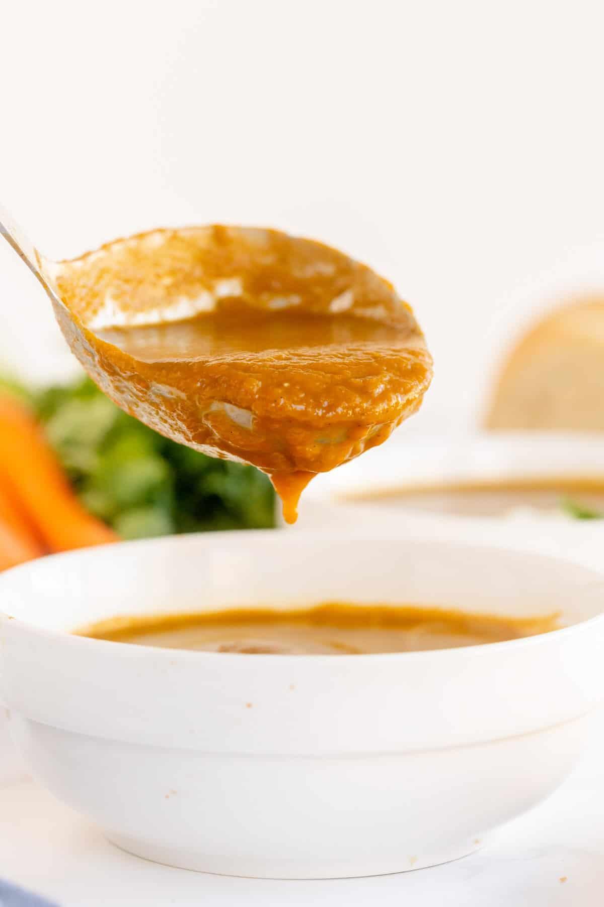 ladle full of carrot soup